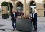 Bürgermeister Dirk Harscher, Hausmeister Udo Diehr, Patrick Weiß vom Bauträger BPD